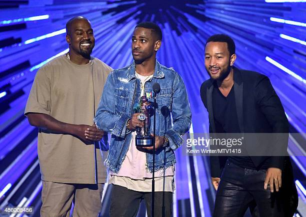 Recording artists Kanye West Big Sean and John Legend accept the Video with a Social Message award for 'One Man Can Change The World' onstage during...