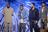 Recording artists Kanye West Big Sean and John Legend accept the Video with a Social Message award for 'One Man Can Change The World' from Jussie...