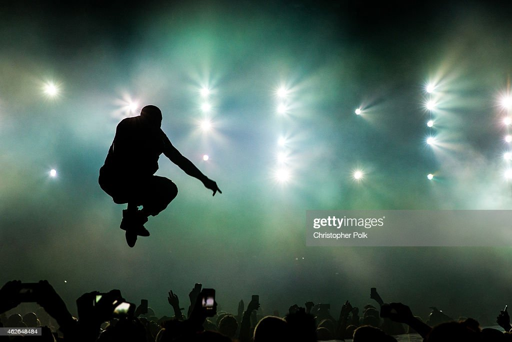 Recording artists Kanye West performs onstage during DirecTV Super Saturday Night hosted by Mark Cuban's AXS TV and Pro Football Hall of Famer...