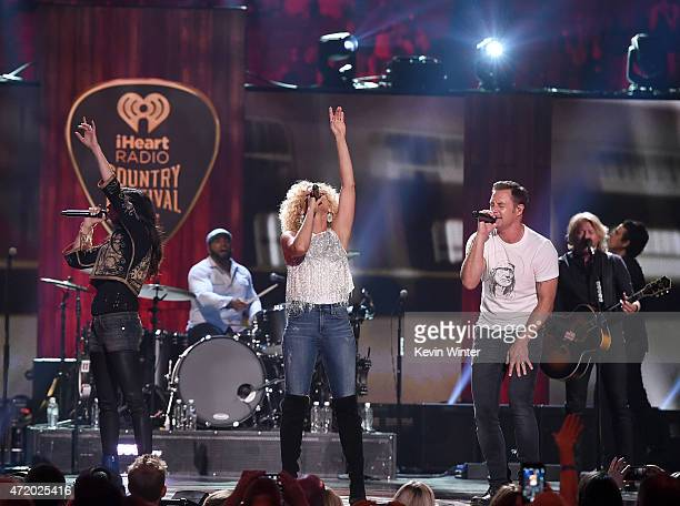 Recording artists Karen Fairchild Kimberly Schlapman Jimi Westbrook and Philip Sweet of Little Big Town perform onstage during the 2015 iHeartRadio...