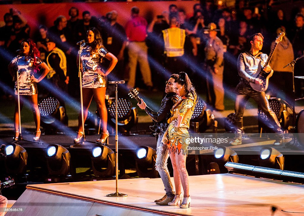 Recording artists Katy Perry and Lenny Kravitz perform onstage during the Pepsi Super Bowl XLIX Halftime Show at University of Phoenix Stadium on February 1, 2015 in Glendale, Arizona.