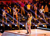 Recording artists Katy Perry and Lenny Kravitz perform onstage during the Pepsi Super Bowl XLIX Halftime Show at University of Phoenix Stadium on...