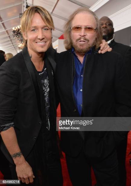Recording artists Keith Urban and Barry Gibb attend The 59th GRAMMY Awards at STAPLES Center on February 12 2017 in Los Angeles California