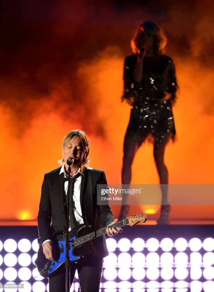Recording artists Keith Urban (L) and Carrie Underwood perform onstage during the 52nd Academy of Country Music Awards at T-Mobile Arena on April 2, 2017 in Las Vegas, Nevada.
