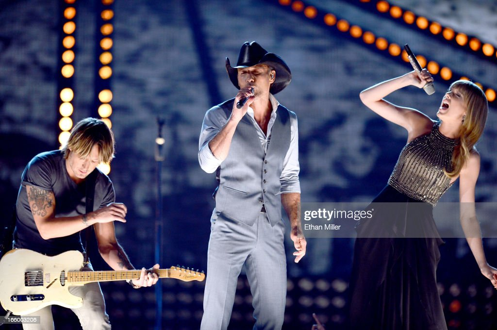 Recording artists Keith Urban, Tim McGraw and Taylor Swift perform onstage during the 48th Annual Academy of Country Music Awards at the MGM Grand Garden Arena on April 7, 2013 in Las Vegas, Nevada.