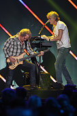 Recording artists Ken 'Spider' Sinnaeve and Doug Johnson of music group Loverboy perform on stage during the iHeart80s Party 2016 at The Forum on...