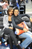 Recording Artists Keri Hilson and Monica attend the Los Angeles Lakers vs Atlanta Hawks game at Philips Arena on March 31 2010 in Atlanta Georgia