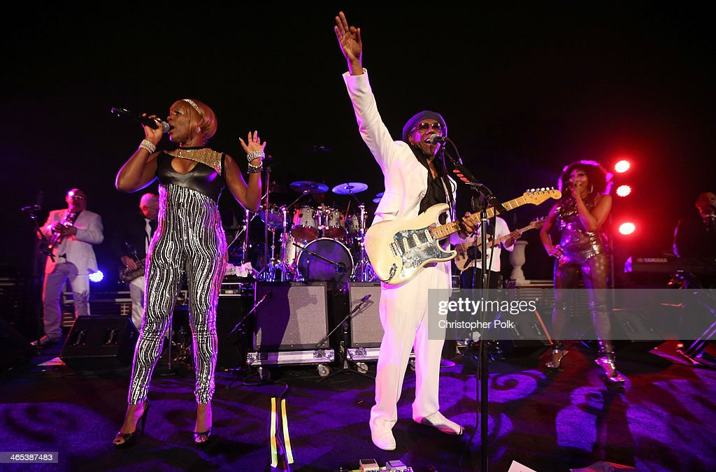 Recording artists Kimberly Davis (L) and <a gi-track='captionPersonalityLinkClicked' href=/galleries/search?phrase=Nile+Rodgers&family=editorial&specificpeople=217582 ng-click='$event.stopPropagation()'>Nile Rodgers</a> perform onstage during the Warner Music Group annual GRAMMY celebration at Sunset Tower on January 26, 2014 in West Hollywood, California.