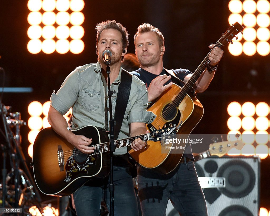 Recording artists Kip Moore (L) and Dierks Bentley perform onstage during ACM Presents: Superstar Duets at Globe Life Park in Arlington on April 17, 2015 in Arlington, Texas.