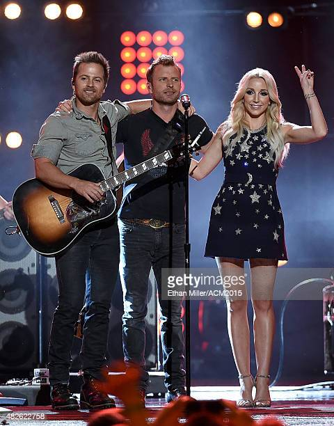 Recording artists Kip Moore Dierks Bentley and Ashley Monroe perform during ACM Presents Superstar Duets at Globe Life Park in Arlington on April 17...