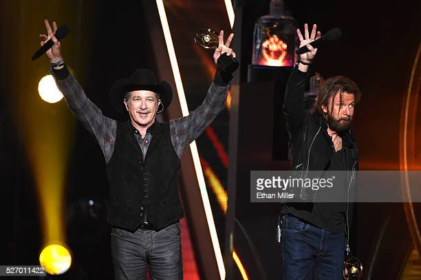 Recording artists Kix Brooks and Ronnie Dunn of Brooks Dunn perform onstage during the 2016 American Country Countdown Awards at The Forum on May 1...