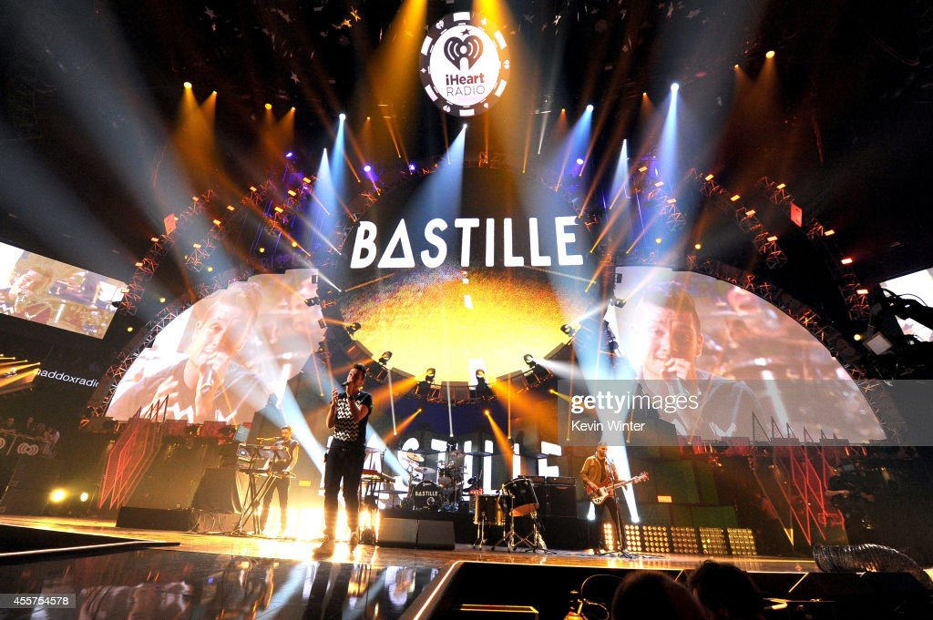 Recording artists Kyle J Simmons Dan Smith Chris 'Woody' Wood and William Farquarson of the band Bastille perform onstage during the 2014 iHeartRadio...