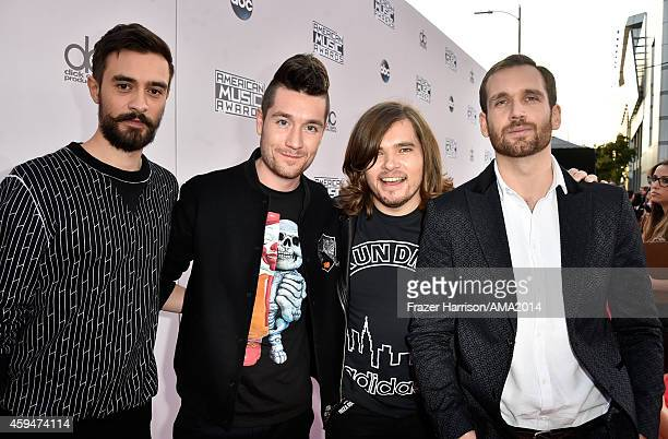 Recording artists Kyle Simmons Dan Smith Chris 'Woody' Wood and Will Farquarson of Bastille attend the 2014 American Music Awards at Nokia Theatre LA...