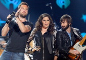 Recording artists Lady Antebellum's Charles Kelley Hillary Scott and Dave Haywood perform onstage during iHeartRadio Country Festival in Austin at...