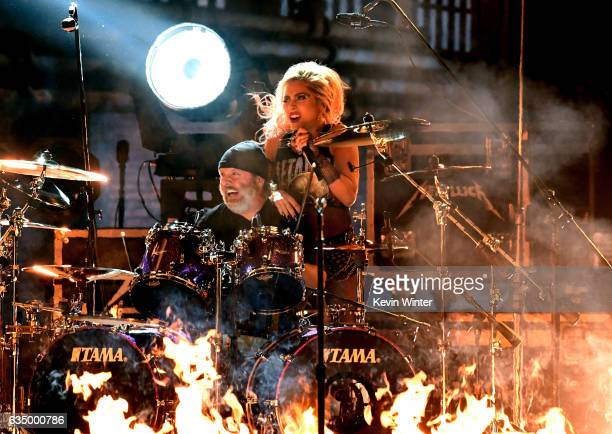 Recording artists Lars Ulrich of music group Metallica and Lady Gaga perform onstage during The 59th GRAMMY Awards at STAPLES Center on February 12...