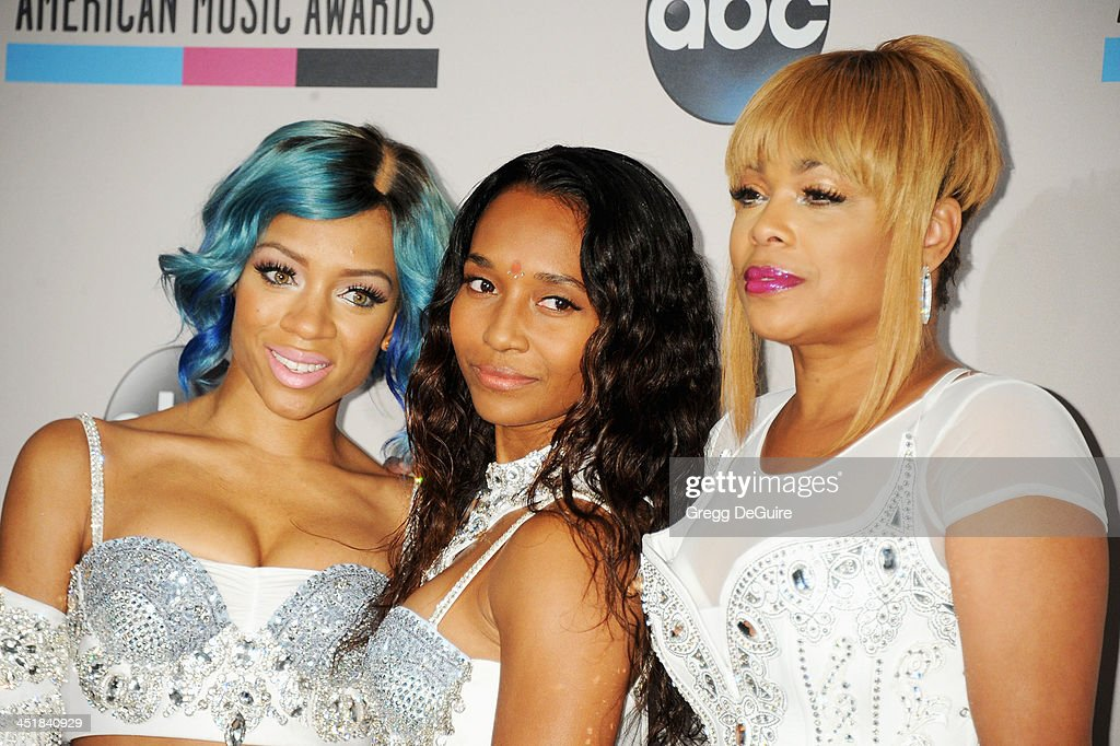 Recording artists Lil' Mama and music group TLC members Chilli and TBoz pose in the press room at the 2013 American Music Awards at Nokia Theatre LA...