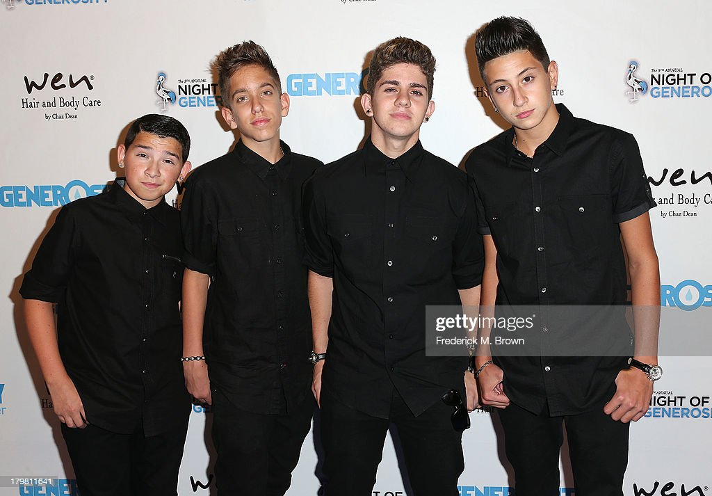 Recording artists Louis DiPippa, Jason Smith, Madison Alamia and Mikey Fusco of ToBeOne attend Generosity Water's 5th Annual Night of Generosity Benefit at the Beverly Hills Hotel on September 6, 2013 in Beverly Hills, California.