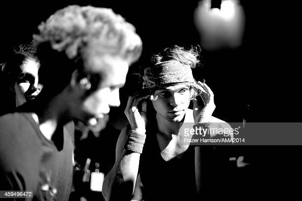 Recording artists Luke Hemmings and Ashton Irwin of 5 Seconds of Summer attend the 2014 American Music Awards at Nokia Theatre LA Live on November 23...