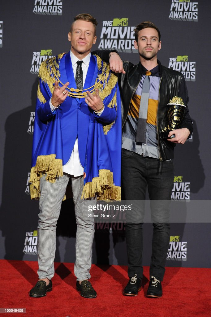 Recording artists <a gi-track='captionPersonalityLinkClicked' href=/galleries/search?phrase=Macklemore&family=editorial&specificpeople=7639427 ng-click='$event.stopPropagation()'>Macklemore</a> (L) and Ryan Lewis pose in the press room during the 2013 MTV Movie Awards at Sony Pictures Studios on April 14, 2013 in Culver City, California.