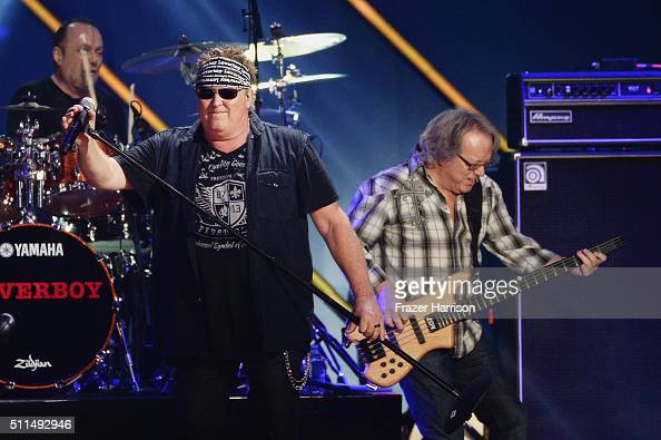 Recording artists Matt Frenette Mike Reno and Ken 'Spider' Sinnaeve of music group Loverboy perform onstage during the first ever iHeart80s Party at...