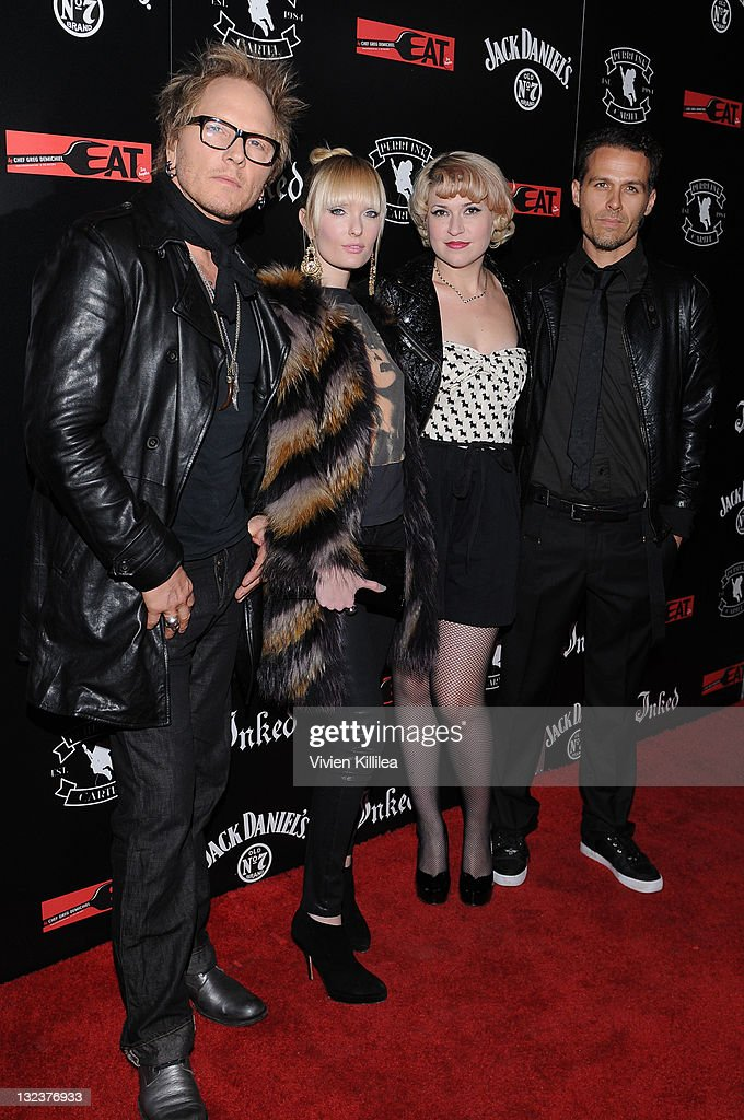 Recording artists <a gi-track='captionPersonalityLinkClicked' href=/galleries/search?phrase=Matt+Sorum&family=editorial&specificpeople=213836 ng-click='$event.stopPropagation()'>Matt Sorum</a>, Ace Harper, Lisa Harriton and Grant Fitzpatrick of Diamond Baby attend the PERRI INK. Cartel Store Opening on November 11, 2011 in Los Angeles, California.