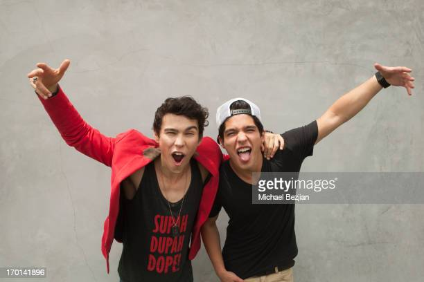 Recording artists Max Schneider and Nicholas Poulios aka Nick Spicy Brown attend Max Schneider visits What's Trending on June 7 2013 in Hollywood...