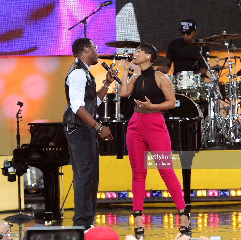 Recording artists Maxwell and <a gi-track='captionPersonalityLinkClicked' href=/galleries/search?phrase=Alicia+Keys&family=editorial&specificpeople=169877 ng-click='$event.stopPropagation()'>Alicia Keys</a> perform on ABC's 'Good Morning America' at Rumsey Playfield on August 30, 2013 in New York City.