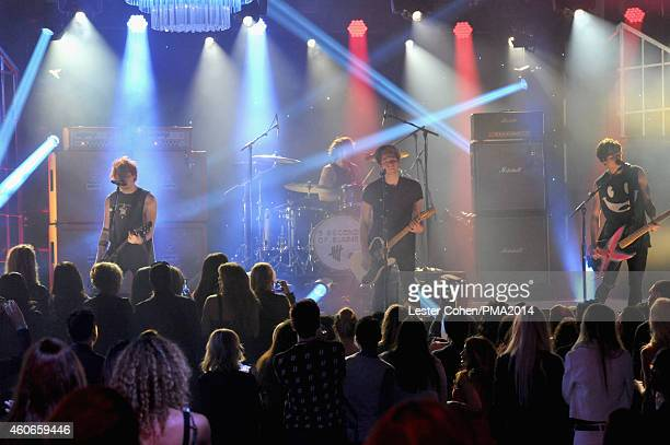 Recording artists Michael Clifford Ashton Irwin Luke Hemmings and Calum Hood of music group 5 Seconds of Summer perform onstage during the PEOPLE...
