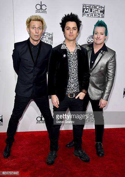 Recording artists Mike Dirnt and Tre Cool attend the 2016 American Music Awards at Microsoft Theater on November 20 2016 in Los Angeles California