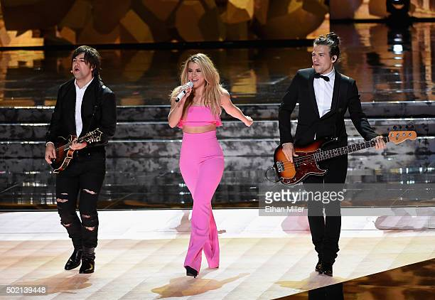 Recording artists Neil Perry Kimberly Perry and Reid Perry of The Band Perry perform during the 2015 Miss Universe Pageant at The Axis at Planet...