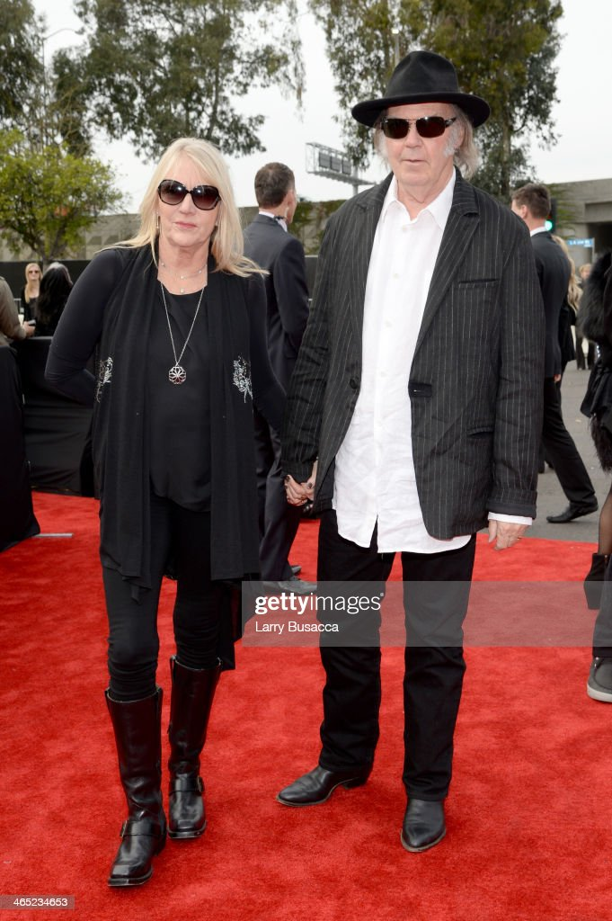 Recording artists Neil Young (R) and Pegi Young attend the 56th GRAMMY Awards at Staples Center on January 26, 2014 in Los Angeles, California.