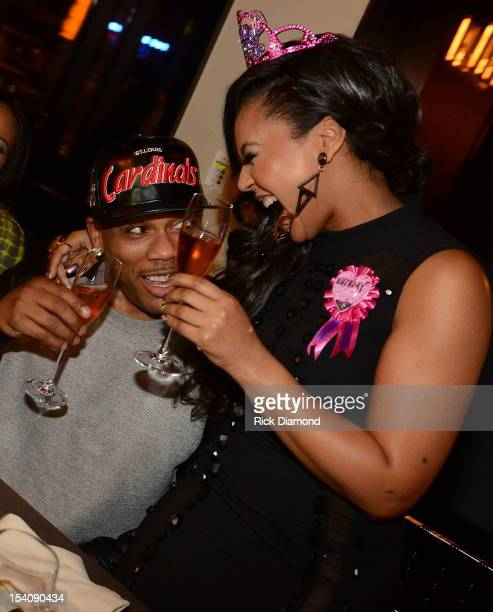 Recording Artists Nelly and Ashanti during Ashanti's surprise birthday dinner hosted by Nelly at STK on October 13 2012 in Atlanta Georgia