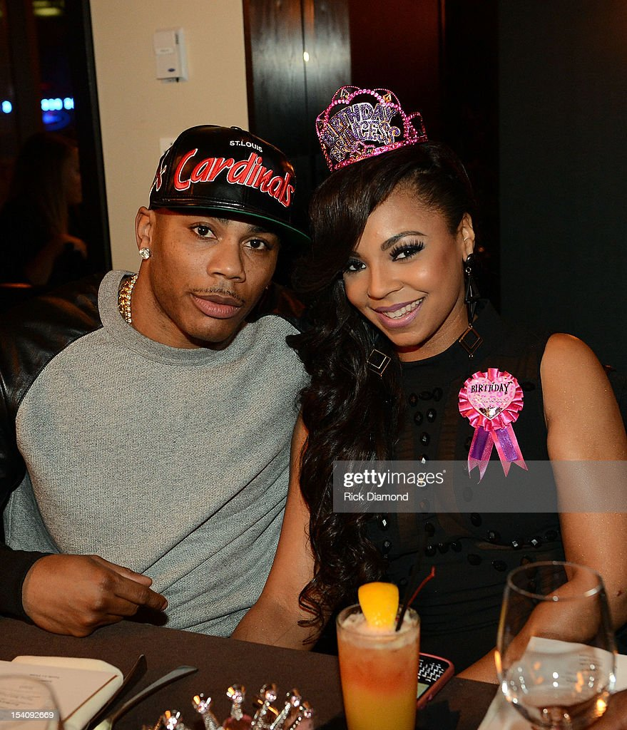 Recording Artists <a gi-track='captionPersonalityLinkClicked' href=/galleries/search?phrase=Nelly+-+Rapper&family=editorial&specificpeople=11499081 ng-click='$event.stopPropagation()'>Nelly</a> and <a gi-track='captionPersonalityLinkClicked' href=/galleries/search?phrase=Ashanti&family=editorial&specificpeople=146300 ng-click='$event.stopPropagation()'>Ashanti</a> during <a gi-track='captionPersonalityLinkClicked' href=/galleries/search?phrase=Ashanti&family=editorial&specificpeople=146300 ng-click='$event.stopPropagation()'>Ashanti</a>'s surprise birthday dinner hosted by <a gi-track='captionPersonalityLinkClicked' href=/galleries/search?phrase=Nelly+-+Rapper&family=editorial&specificpeople=11499081 ng-click='$event.stopPropagation()'>Nelly</a> at STK on October 13, 2012 in Atlanta, Georgia.