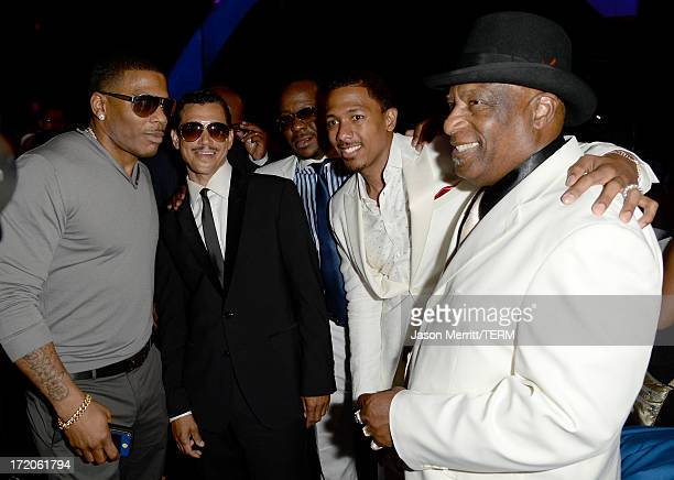 Recording Artists Nelly El DeBarge Bobby Brown TV personality Nick Cannon and his grandfather James Cannon pose in the audience during the 2013 BET...