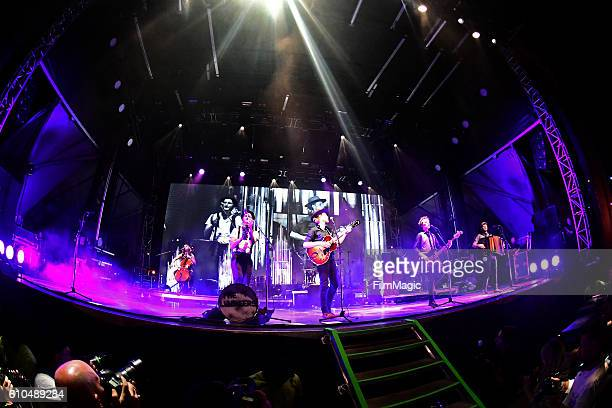 Recording artists Neyla Pekarek Jeremiah Fraites Wesley Schultz Byron Isaacs and Stelth Ulvang of The Lumineers perform on Ambassador Stage during...