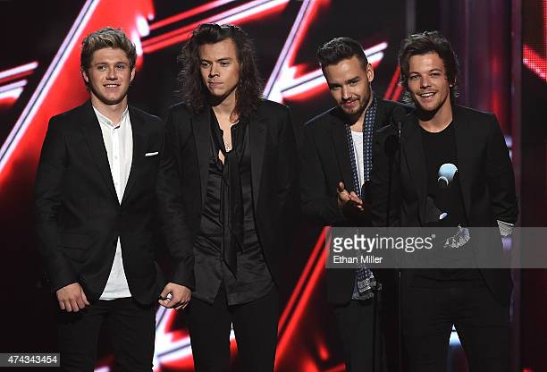 Recording artists Niall Horan Harry Styles Liam Payne and Louis Tomlinson of One Direction present an award during the 2015 Billboard Music Awards at...