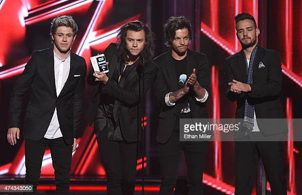 Recording artists Niall Horan Harry Styles Louis Tomlinson and Liam Payne of One Direction present an award during the 2015 Billboard Music Awards at...