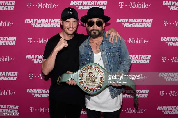 Recording artists Nick Carter and AJ McLean of the Backstreet Boys arrive on TMobile's magenta carpet duirng the Showtime WME IME and Mayweather...
