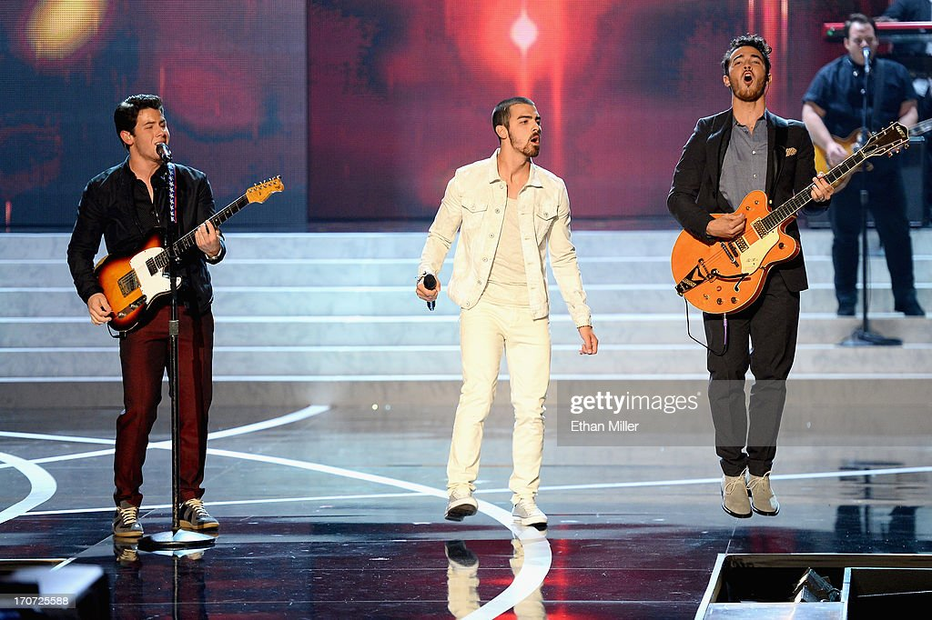 Recording artists Nick Jonas, Joe Jonas and Kevin Jonas of the Jonas Brothers perform onstage during the 2013 Miss USA pageant at PH Live at Planet Hollywood Resort & Casino on June 16, 2013 in Las Vegas, Nevada.