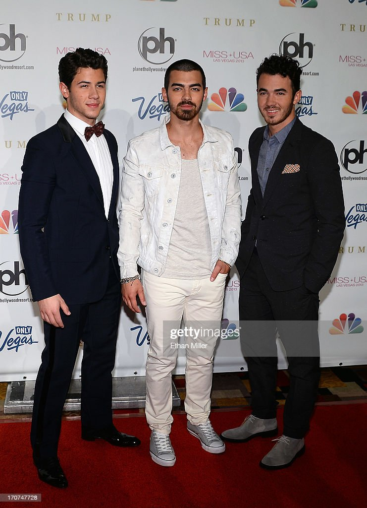 Recording artists <a gi-track='captionPersonalityLinkClicked' href=/galleries/search?phrase=Nick+Jonas&family=editorial&specificpeople=842713 ng-click='$event.stopPropagation()'>Nick Jonas</a>, <a gi-track='captionPersonalityLinkClicked' href=/galleries/search?phrase=Joe+Jonas&family=editorial&specificpeople=842712 ng-click='$event.stopPropagation()'>Joe Jonas</a> and <a gi-track='captionPersonalityLinkClicked' href=/galleries/search?phrase=Kevin+Jonas&family=editorial&specificpeople=709547 ng-click='$event.stopPropagation()'>Kevin Jonas</a> of the Jonas Brothers arrive at the 2013 Miss USA pageant at Planet Hollywood Resort & Casino on June 16, 2013 in Las Vegas, Nevada.