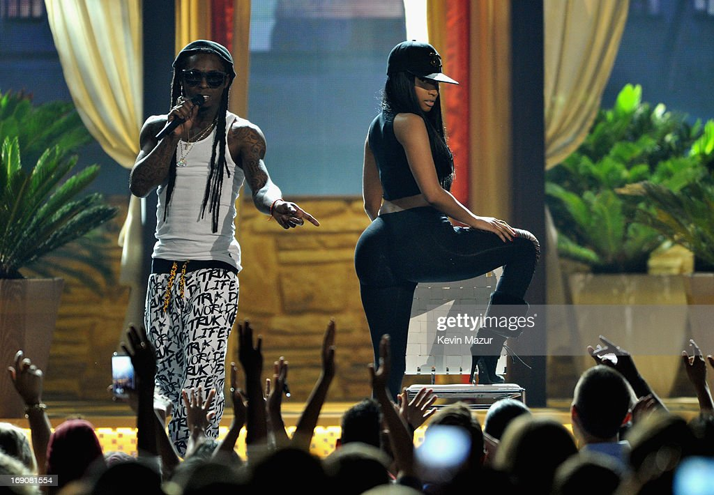 Recording artists <a gi-track='captionPersonalityLinkClicked' href=/galleries/search?phrase=Nicki+Minaj+-+Performer&family=editorial&specificpeople=6362705 ng-click='$event.stopPropagation()'>Nicki Minaj</a> (R) and Lil Wayne perform onstage during the 2013 Billboard Music Awards at the MGM Grand Garden Arena on May 19, 2013 in Las Vegas, Nevada.