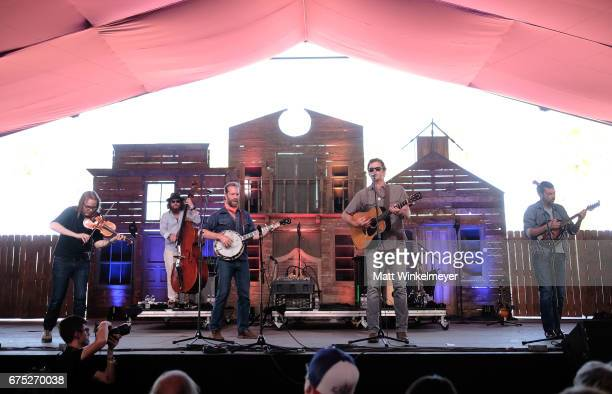 Recording artists Nicky Sanders Charles R Humphrey III Graham Sharp Woody Platt and Mike Guggino of Steep Canyon Rangers perform on the Mustang stage...