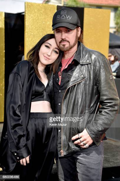 Recording artists Noah Cyrus and Billy Ray Cyrus attend the 2017 MTV Movie And TV Awards at The Shrine Auditorium on May 7 2017 in Los Angeles...
