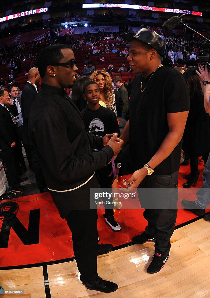 Recording artists P. Diddy and Jay-Z stand courtside during the 2013 NBA All-Star Game presented by Kia on February 17, 2013 at the Toyota Center in Houston, Texas.