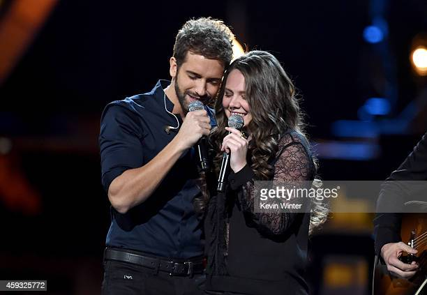 Recording artists Pablo Alboran and Jesse y Joy memberJoy Huerta perform onstage during the 15th annual Latin GRAMMY Awards at the MGM Grand Garden...