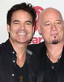 Recording artists Patrick Monahan and Jimmy Stafford of Train pose in the press room at the iHeartRadio Music Festival Night 2 at the MGM Grand...