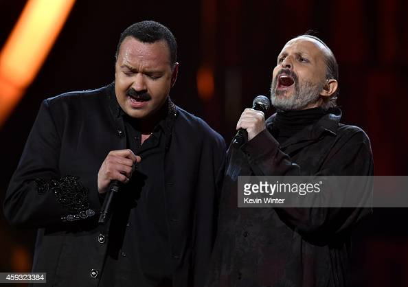 Recording artists Pepe Aguilar and Miguel Bose perform onstage during the 15th annual Latin GRAMMY Awards at the MGM Grand Garden Arena on November...