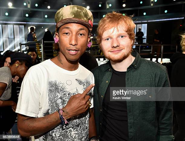 Recording artists Pharrell Williams and Ed Sheeran pose backstage during The 57th Annual GRAMMY Awards at the Staples Center on February 6 2015 in...