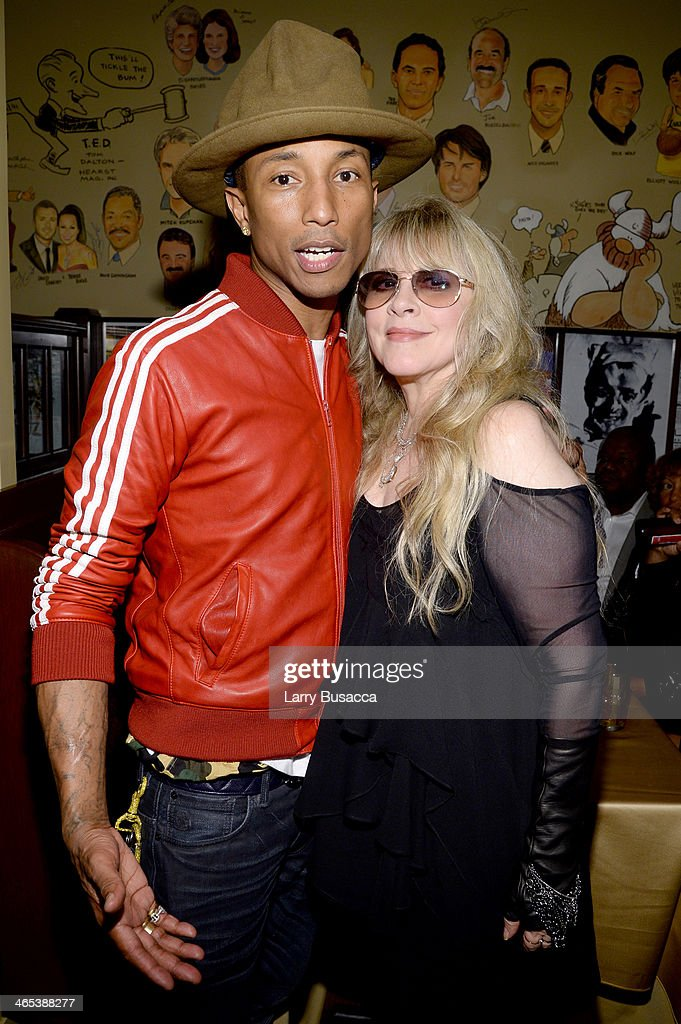 Recording artists <a gi-track='captionPersonalityLinkClicked' href=/galleries/search?phrase=Pharrell+Williams&family=editorial&specificpeople=161396 ng-click='$event.stopPropagation()'>Pharrell Williams</a> (L) and <a gi-track='captionPersonalityLinkClicked' href=/galleries/search?phrase=Stevie+Nicks&family=editorial&specificpeople=212751 ng-click='$event.stopPropagation()'>Stevie Nicks</a> attend the Sony Music Entertainment Post-Grammy Reception at The Palm on January 26, 2014 in Los Angeles, California.