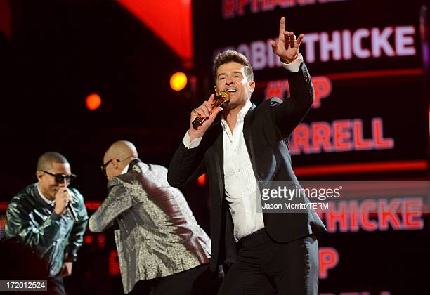 Recording artists Pharrell Williams TI and Robin Thicke perform onstage during the 2013 BET Awards at Nokia Theatre LA Live on June 30 2013 in Los...